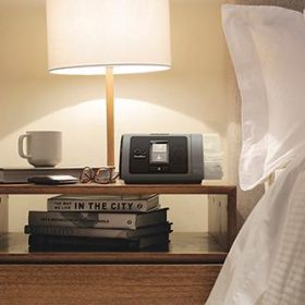 image of a Cpap Machine close to bed
